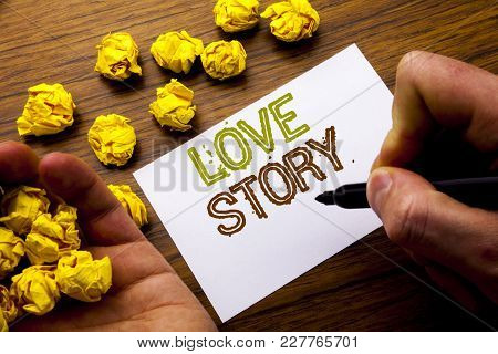 Word, Writing Love Story. Concept For Loving Someone Heart  Written On Notebook Note Paper On Wooden