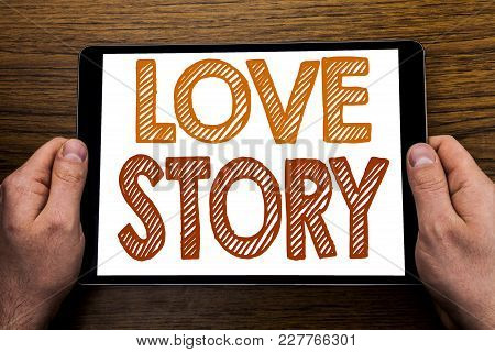 Hand Writing Text Caption Love Story. Business Concept For Loving Someone Heart  Written Tablet Lapt