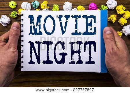 Writing Text Showing Movie Night. Business Concept For Wathing Movies  Written Notepad Notebook Book