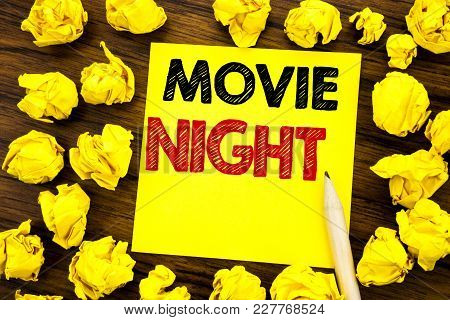 Writing Text Showing Movie Night. Business Concept For Wathing Movies  Written On Sticky Note Paper,