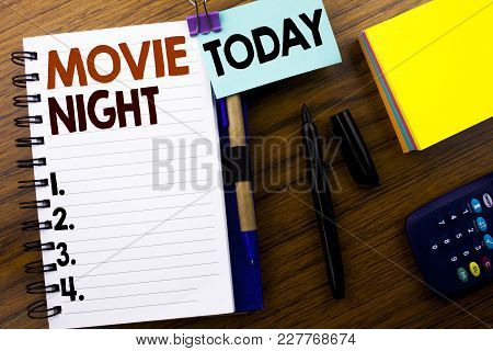 Word, Writing Movie Night. Business Concept For Wathing Movies  Written On Book Note Paper On Wooden