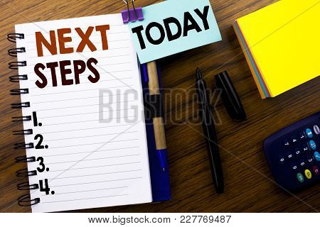Word, Writing Next Steps. Business Concept For Future Golas And Target Written On Book Note Paper On