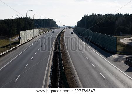 The High-speed Road Seen From The Viaduct. Two-lane Road And Cars On The Way.
