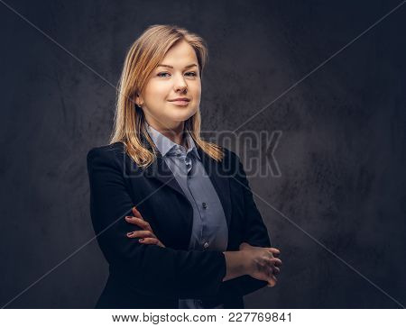 Studio Portrait Of A Blonde Businesswoman In A Formal Suit.