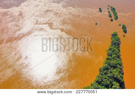 Aerial View Of Iguazu River With The Reflection Of The Sun. Argentina And Brazil.