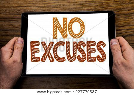 Hand Writing Text Caption No Excuses. Business Concept For Stop Ban For Excuse Written Tablet Laptop