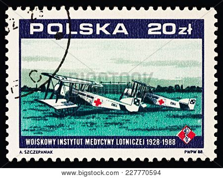 Moscow, Russia - January 23, 2017: A Stamp Printed In Poland Shows Two Old Ambulance Airplanes (1928