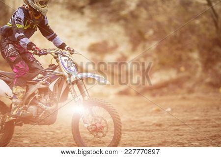 Motocross, Enduro Rider On Dirt Track. Extreme Off-road Race. Hard Enduro Motorbike. The Forest Behi