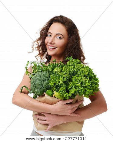 Young Woman Hold Grocery Paper Shopping Bag Full Of Fresh Green Vegetables. Diet Healthy Eating Conc