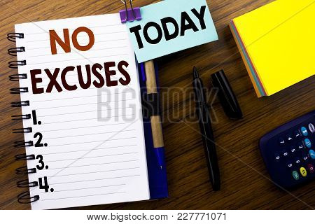 Word, Writing No Excuses. Business Concept For Stop Ban For Excuse Written On Book Note Paper On Woo