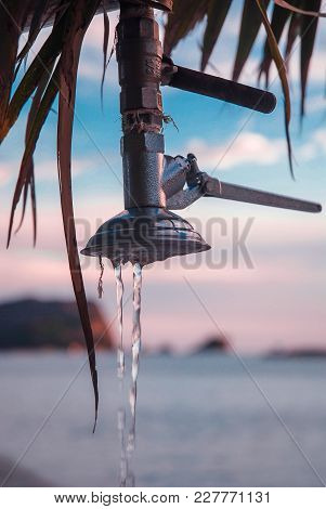 The Water Flows In A Thin Streem From The Beach Shower