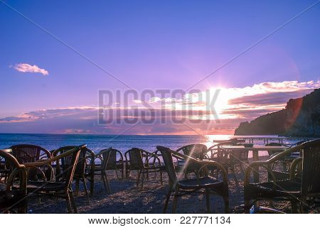 Empty Cafe On The Beach At Sunset By The Sea