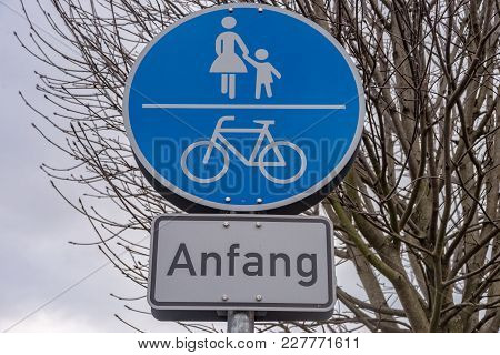 A Road Sign For The Start Of A Footpath And A Bicycle Lane