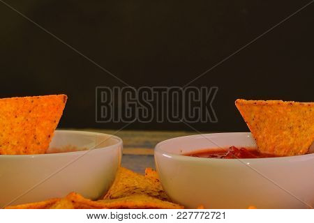 Chili Corn-chips With Salsa Dip On Wooden Background. Black Copy Space For Text.