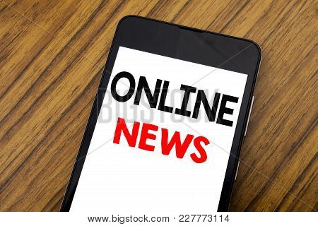 Word, Writing Handwriting Online News. Business Concept For Online Newspaper Article Written On Mobi