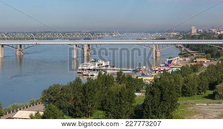 Novosibirsk, Russia - July 20, 2013: Octyabrsky Bridge Across The River Ob In Novosibirsk In Summer