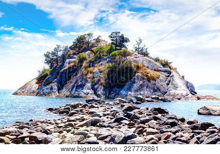 Exposed Rocks On Low Tide Lead To Popular Whyte Islet Park On Whytecliff Island At Whytecliffe Park