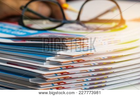 Stack Of Report Paper Documents For Business Desk With Glasses, Business Papers For Annual Report Fi