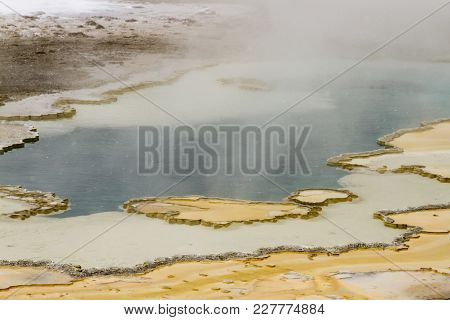 Steaming Over Rock Formation In Upper Geyser Basin, Yellowstone National Park