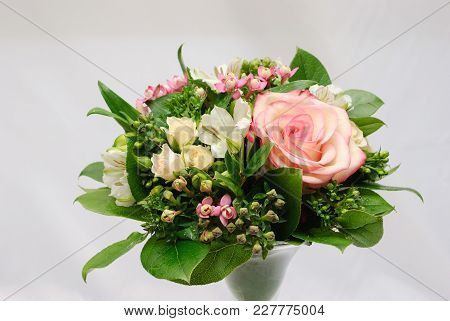 Greeting Bouquet Of Rose Bush, Alstroemeria, Bouvardia And Salal In Glass Vase On White Background