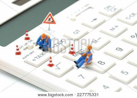 Miniature People Construction Worker Keypad Tax Button For Tax Calculation. Easy To Calculate. On Wh