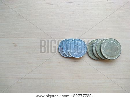 Thai Baht Coins With Copy Space On Wooden Table Background