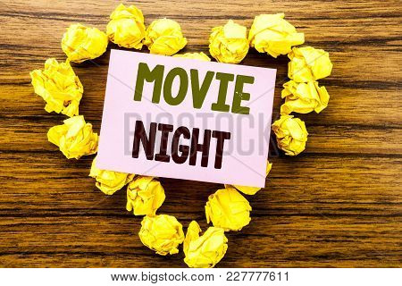 Word, Writing Movie Night. Business Concept For Wathing Movies  Written On Sticky Note Paper On Wood