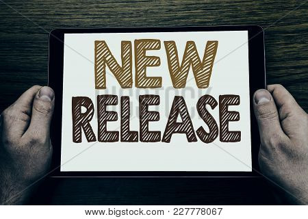 Hand Writing Text Caption New Release . Business Concept For Technology Software Update Written Tabl
