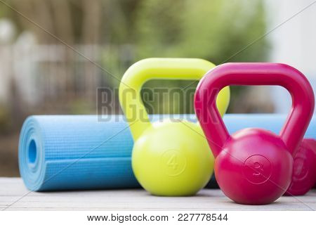 Kettlebell, Dumbbell And Yoga Mat On Table, Fitness Healthy And Sport Concept