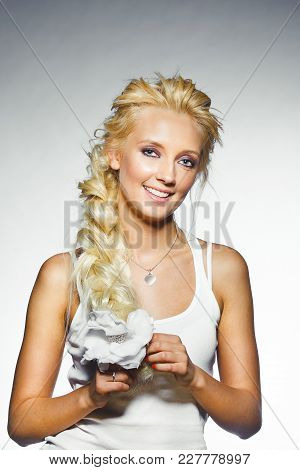 Portrait Of Young Smiling Woman With Thick Blond Hair And Natural Clean Skin. Studio Shot Cute Girl