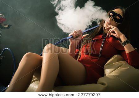Closeup Young, Beautiful Girl Smoke A Hookah At Club. Sexy Woman Smoking. Fashion