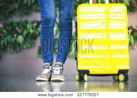Woman Carries Your Luggage At The Airport Terminal Of Hong Kong, After Gonna Stady Or Education Fly