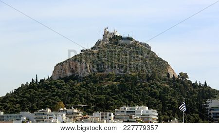 Mount Lycabettos Limestone Hill With Chapel On Top In Athens