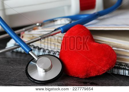 Stethoscope For Doctor And Medical Nursing People In Hospital, Healing Of Patients. Wooden Backgroun