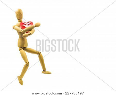 Wooden Puppet With Red Origami Heart Dancing Isolated On White Background