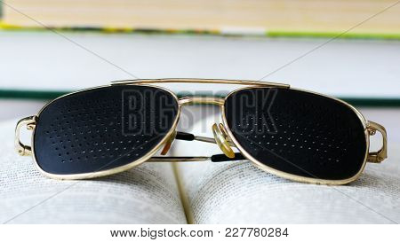 Black Medical Glasses With Holes And Book