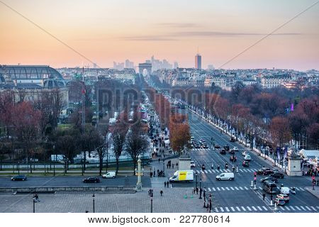 PARIS, FRANCE - CIRCA DECEMBER 2016: Place de la Concorde and the Champs-Elysees aerial view from the ferris wheel at sunset.