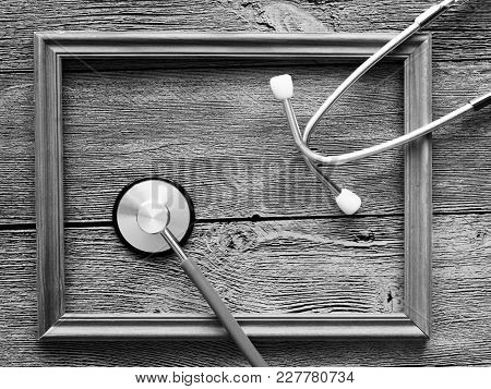 Stethoscope For Doctor And Wooden Frame