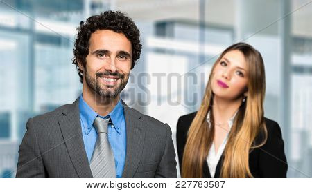 Two business partners smiling