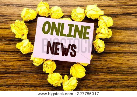 Word, Writing Online News. Business Concept For Online Newspaper Article Written On Sticky Note Pape