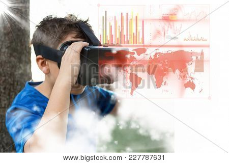 Digital composite of Composite image of kid using virtual reality