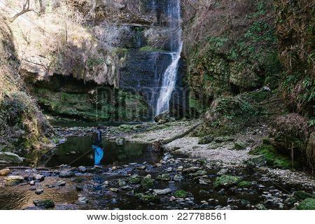12 Year Old Boy Walking Near Fermona Waterfall Ferrera, Italy
