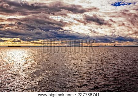 The Sun Is Setting Over The Baltic Sea. You Can See The Skyline Of Tallinn, The Capital Of Estonia,