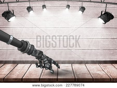 Digital composite of Android Robot hand pointing on wood under spotlights