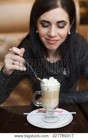 Close-up Portrait Of A Lovely Female Drinking Latte At A Cafeteria