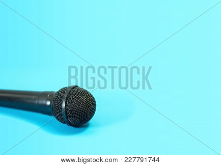 Microphone Of Black On Blue Background.  Entertainment Concept