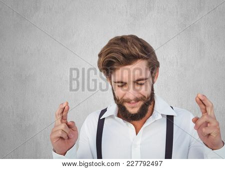 Digital composite of Young men asking a desire with his fingers crossed