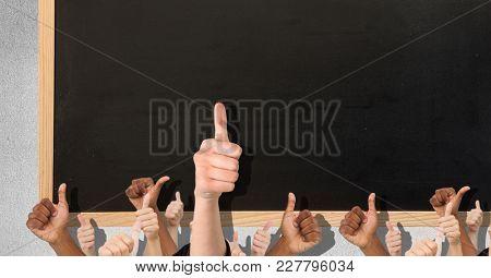 Digital composite of Thumbs up black blackboard