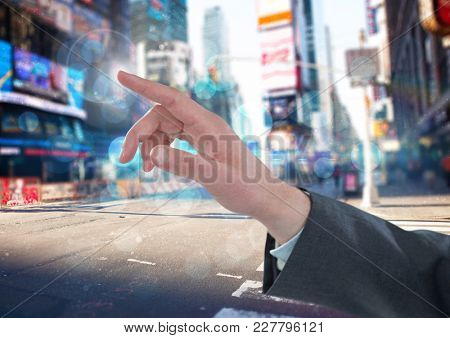 Digital composite of Hand Touching air of city street