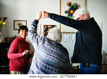 Senior people dancing together